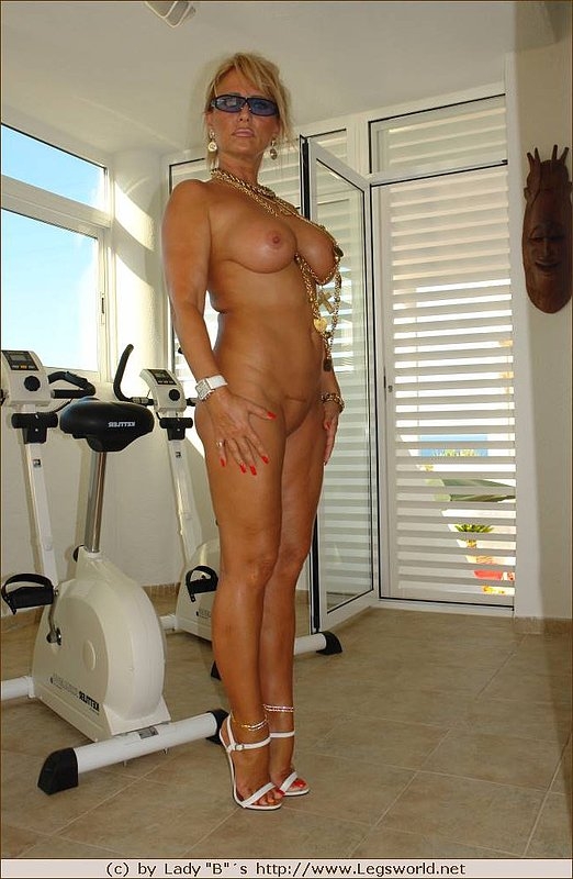 big breasted mom is posing naked after the workout
