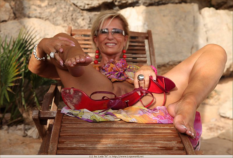 Outstanding mature mom is relaxing on the deck chair
