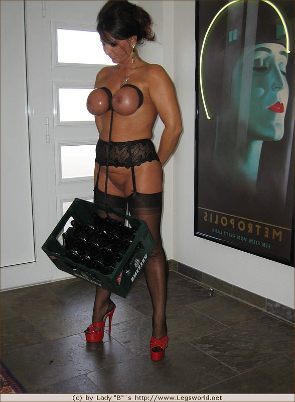 naked mom is hanging some bottles on her tits