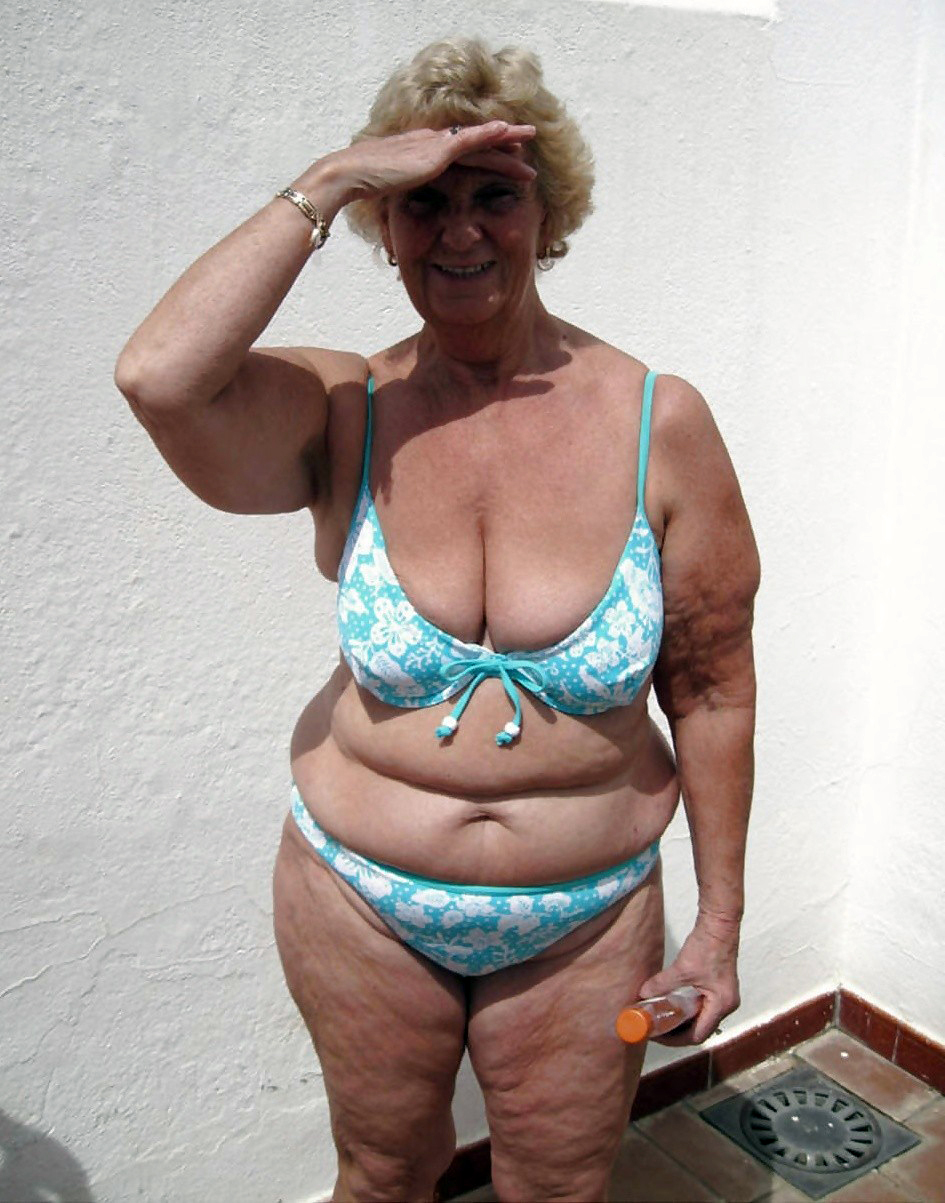 image Granny sucking more cock at the beach