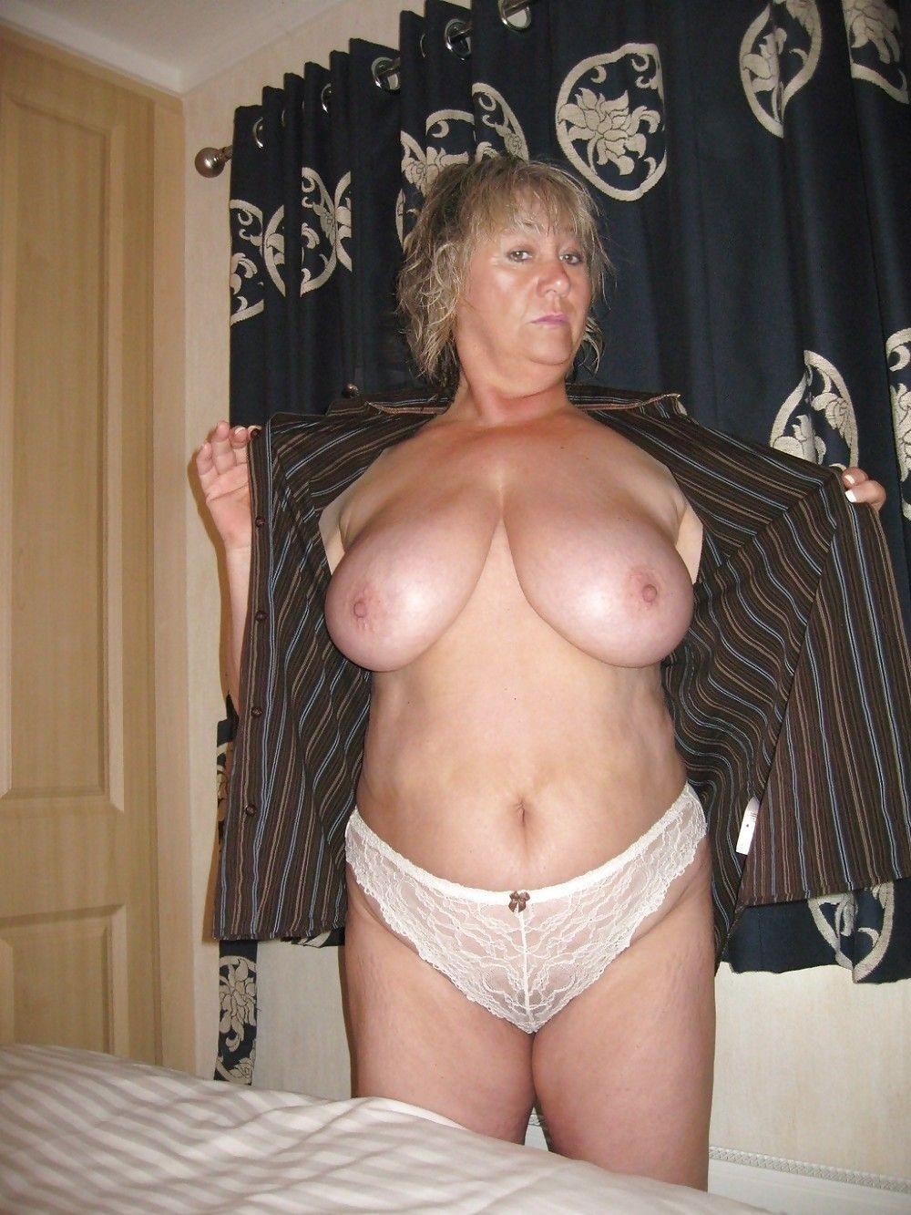 Mature woman using vibrator