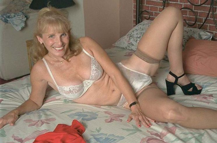Experienced milf with a huge pair of tits fucks young stud 2