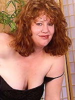 Chubby mature redhead in her 56 don't care that her pussy is not that wet