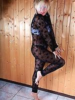 Cute MILF is posing in a full-body nylons