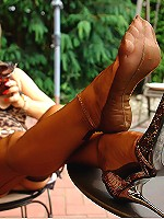Blonde MILF showing off her sexy feet in nylons outdoors