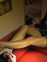 Lady Barbara is featured in a hot nylon fetish scene