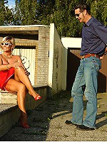 Gorgeous blonde mature lady gets her feet cleaned and legs worshiped outdoors