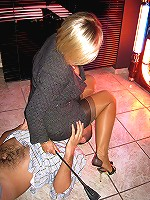 Hot femdom cougar enjoys spanking and controlling sissy dude on his butt